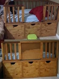 diy toddler bed with storage and a slide in door for preventing