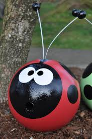 recycled bowling for garden ornaments the wind will