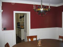 living room with framed wall arts and burgundy walls burgundy