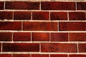 dark brown bricks stones wall photo texture u0026 background