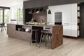sleek modern kitchen featuring white gloss doors textured island