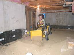 dirk the digger helps dig level the dirt in the basement crawl space