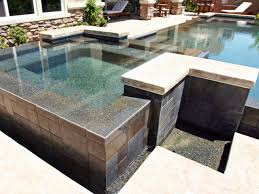 this lovely backyard pool and spa utilizes sharp geometric shapes