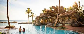 infinity pool small backyard infinity pool villa private a couple unwinds in the waters of the ka maka grotto oceanfront pool while looking out
