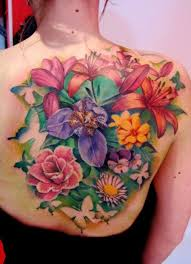 colored flowers tattoos on hip