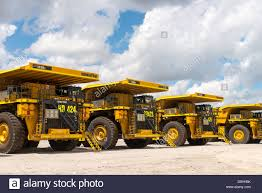 large mining dump trucks parked up stock photo royalty free image
