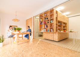Movable Walls For Apartments Sliding Shelving Unit Combines Five Functions In One Space