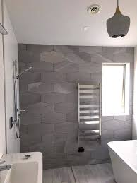 stone cut grey hexagonal feature wall in a very stylish bathroom