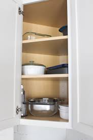 how to organize corner kitchen cabinets tips to organize kitchen cabinets and drawers the diy playbook