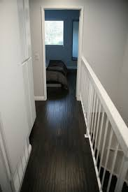 White Walls Grey Trim by First Home Renovation Floating Stairs Wall Wood And Valspar