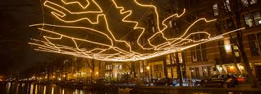 all seeing and wormholes light up amsterdam s festival of lights