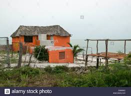 two story roof stock photos two story roof stock images alamy orange two story thatched roof house on the gulf of mexico campeche state mexico