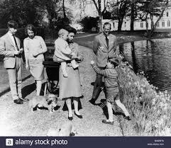 queen elizabeth ii and family walking with corgis including prince