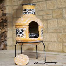 exterior yellow clay chiminea for exciting patio heater design