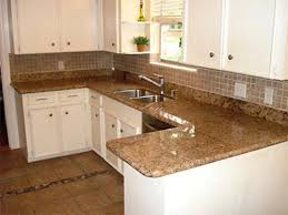 Baltic Brown Granite Countertops With Light Tan Backsplash by Kitchen Amusing White Kitchen Cabinets With Brown Granite