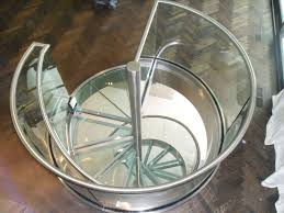 custom made spiral glass and stainless steel stair by foreman
