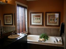 decorating tan wall with glass window and faux wood blinds plus