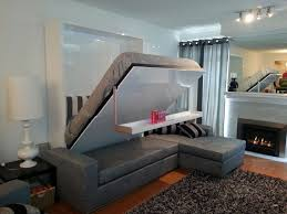 bedroom modern wooden murphy bed with small sofa and floating