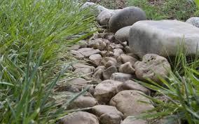 drainage problem causes backyard lake french drain the answer