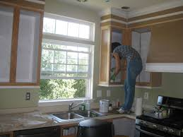 How To Paint Kitchen Cabinets by Remodelando La Casa Painting The Kitchen Cabinets