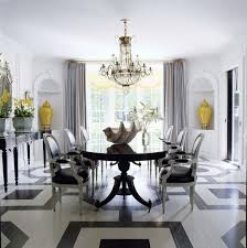 gorgeous dining room with crystal chandelier over large dining