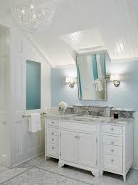 light gray bathroom vanity with pale blue walls transitional