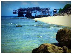 nauru is a small phosphate rock island in the south pacific ocean