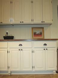 granite countertops white beadboard kitchen cabinets lighting