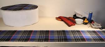 how to reupholster an ottoman with a vintage pleated plaid skirt