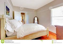 White And Beige Bedroom Bright Bedroom With White Bed And Beige Walls Stock Image Image