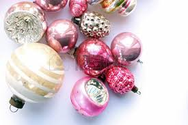 vintage pink and pastel colored vintage ornaments above view