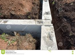 Building A Concrete Block House Concrete Building Block House Foundations In Earth Stock Photo
