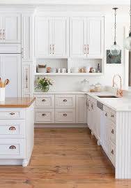 white kitchen cabinets raised panel white kitchen cabinets with copper cup pulls and copper sink
