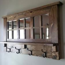 oak entryway shelf with mirror and coat hangers entryway wooden