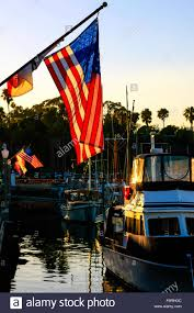 American Flag Sunset American Flag At Sunset With The Sun Behind It At Santa Barbara