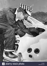 james dean with the porsche sypder in which he was killed in a