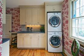 furniture white stackable washer and dryer with white cabinet on