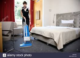 hotel room service house keeping at work in a hotel room