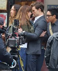 movie fifty shades of grey come out fifty shades of grey teaser poster shows jamie dornan surveying