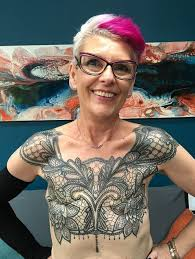gets chest to cover mastectomy scars
