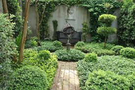 outdoor courtyard small french courtyard gardens planted with shrubs and small trees