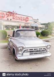 Vintage Ford Truck Bumpers - a silver vintage pickup truck in front of a classic americana
