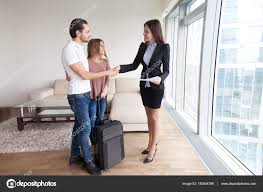Travellers couple shaking hands with real estate agent vacation