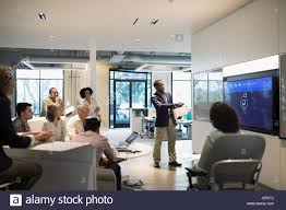 businessman leading audio visual presentation in conference room