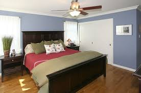 modern guest bedroom with crown molding ceiling fan in redwood