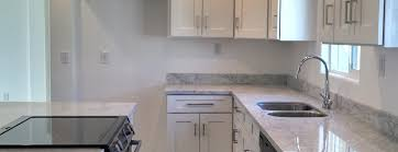 carrara marble kitchen island white shaker kitchen cabinets with carrara marble countertops