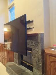 mounting a tv over a fireplace tv and safety tv mounting over