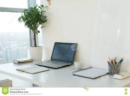 designer computer table side view picture of studio workplace with blank notebook laptop