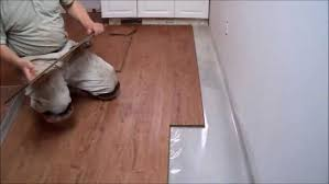 how to install laminate flooring on concrete in the kitchen fit under skirting around stairs