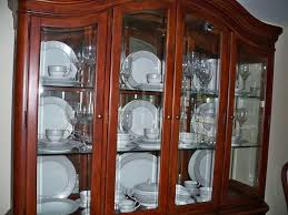 how to arrange dishes in china cabinet pin on dining room hutch